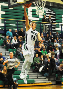 The Wolfpack's Tadan Gilman scores a basket on a fastbreak during the first quarter against Frenchtown on Friday. (Aaric Bryan/Daily Inter Lake)