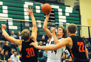Glacier's Noah Lindsay puts up a shot over Frenchtown's Andrew King (30) and Austin Means (22) during the first quarter on Friday. (Aaric Bryan/Daily Inter Lake)